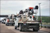 Electrical Company trucks driving southwest on Hwy 40 from Michegan, Kansas, Virginia, and Indiana to restore electricity in Louisiana and Mississippi after Hurricane Gustav