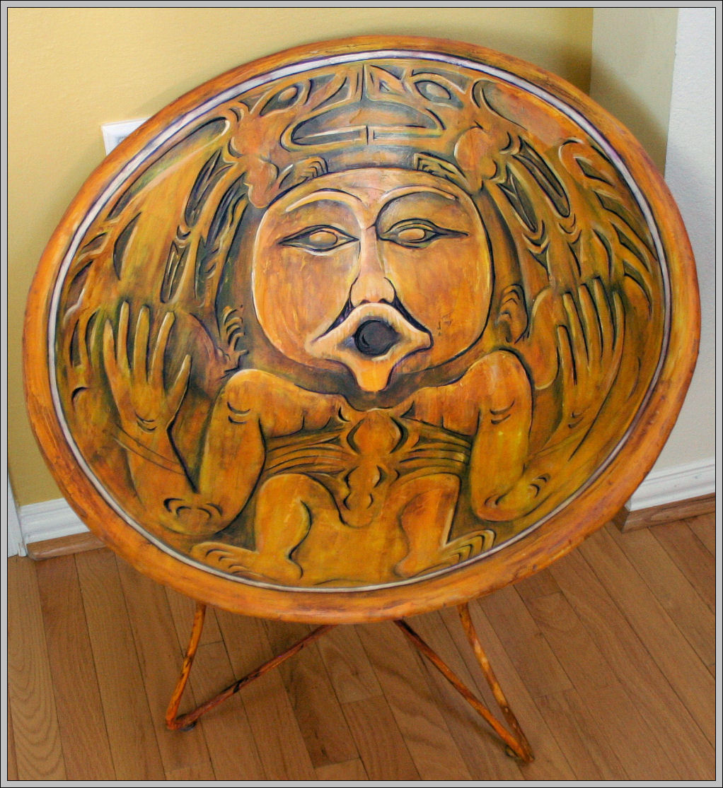 Salish Spindle-whorl Replica Chair, front partially carved, back painted to look like carved wood